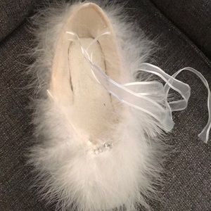 Decorative fur covered ballet pointe shoe
